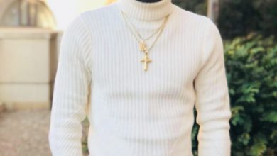 Photo of Shatta Wale wears an AMG merchandise to shoot a Jamaican music video