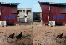 Photo of Photo of a 'Ghetto champion' using air conditioner in his 'wooden kiosk house'